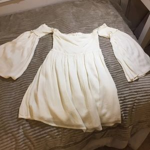 Flowy white off-the-shoulder  bell-sleeved dress